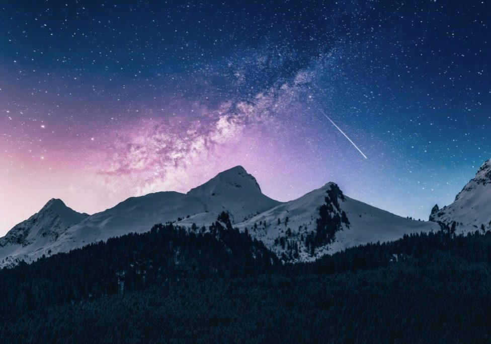 stunning mountain sky with shooting star