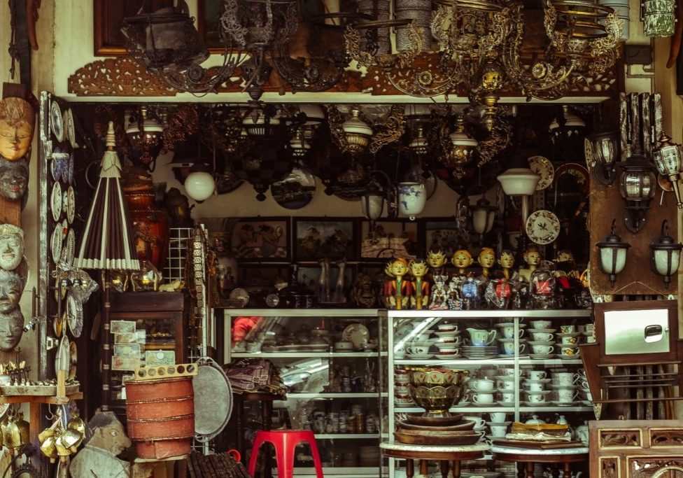 antique shop with lots of brass and jars