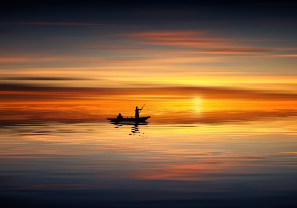 fishing boat in stunning sunset