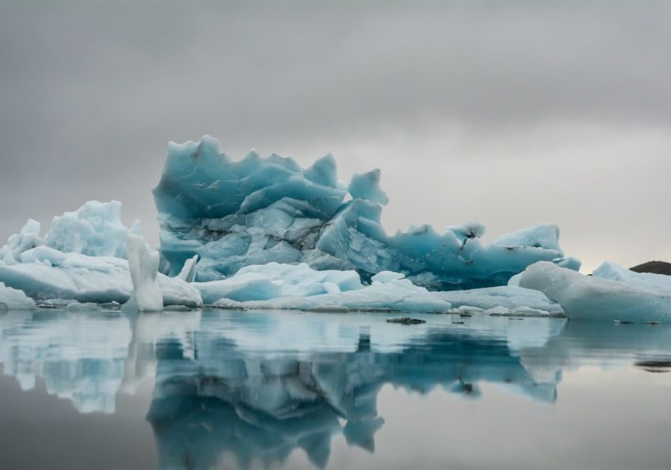 water and ice in a blue iceburg